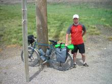The author, Travis Poppe, by his touring bike.