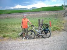 Fellow cyclist and friend, Korey Pelton, beside his mountain bike.